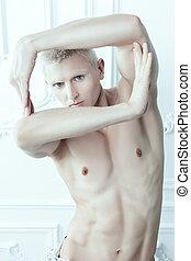 Man shows a figure - Male albino makes shapes with his hands...
