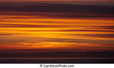 Time lapse over clouds during beautiful sunset - Aerial pan...