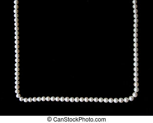 White pearls on the black velvet background