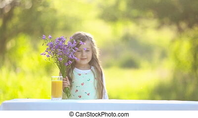 Girl drinking orange juice - girl drinking orange juice in...