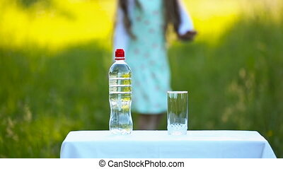 she poured water from a bottle