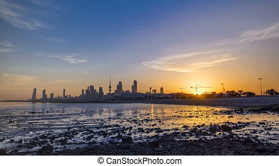 Seaside skyline of Kuwait city sunrise timelapse