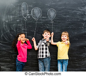 three smiling children with thumbs up keeping imaginaru...