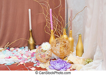 decor of candles and flowers at the wedding table in a...