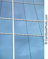 Blue Glass Windows reflect clouds with white lines framing...