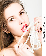 close-up portrait of a beautiful girl with red lips, holding...