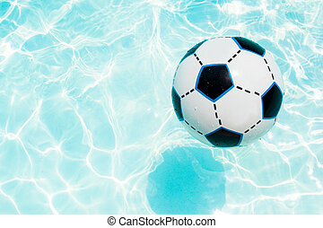 Beach ball in the swimming pool