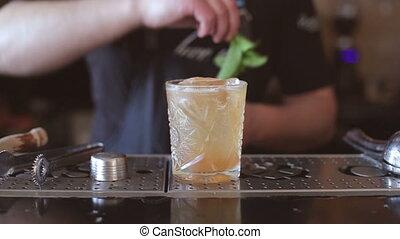 Barthender makes cocktails at the bar