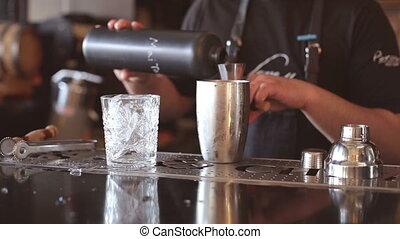 Bartender makes cocktails at the bar