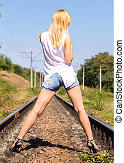 Young girl standing on iron paths - Concept of tourism and...