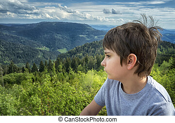 Portrait of a schoolboy on a background of mountain...