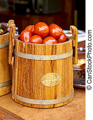 Marinated tomatoes in a barrel. Home cooking