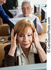 Stressed Senior Woman In Computer Class