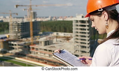 woman architect checks with the construction plan