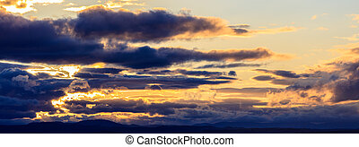 Cloudy heaven at sunset - Panoramic view on idyllic...