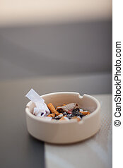 Burned cigarette in ashtray - View of burned cigarette in...