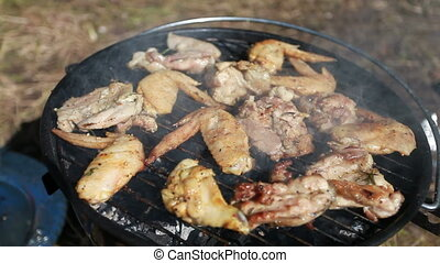 Chicken on open fire barbecue - Cooking chicken on open fire...