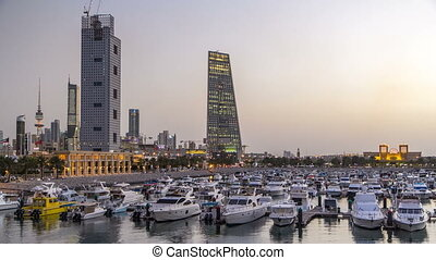 Yachts and boats at the Sharq Marina day to night timelapse in Kuwait. Kuwait City, Middle East