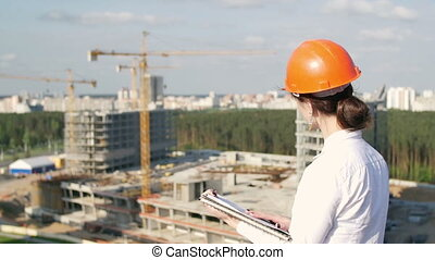 Woman architect inspects the construction site - Woman...