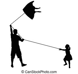playing with kite silhouettes - father and daughter playing...