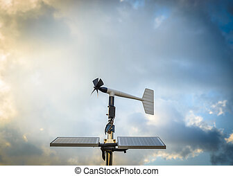Anenometer against a dramatic sky - A solar powered...