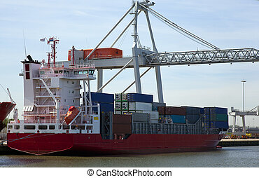 container ship in the harbour of rotterdam