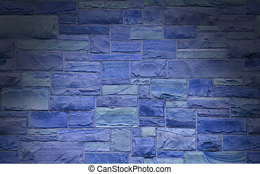 Blue masonry wall lit dramatically