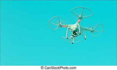 Drone with camera flying in the sky