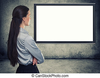 rear view of woman looking at blank screen - rear view of...