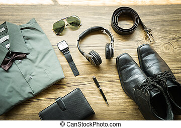 Mens casual outfits with accessories on on wood background...