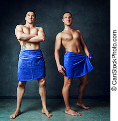 men with towels - two attractive young men wearing towels...