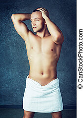 man with a towel - attractive young man with a towel after...