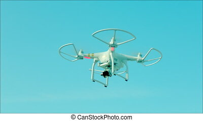 Drone with fixed camera on it flying in the air - Drone...
