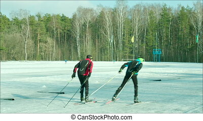 Skiers training at the stadium - Clip of people in track...