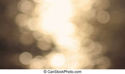 Blinking particles. Defocused water - Golden sun lights...