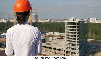 Architect looking on development project - Architect looking...