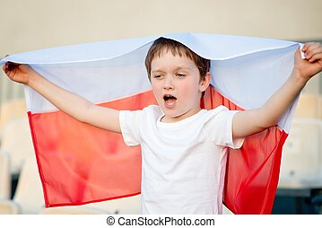 Polish football fan - little boy with Polish flag supporting...