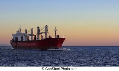 Cargo ship sailing from open sea - A bulk carrier ship with...