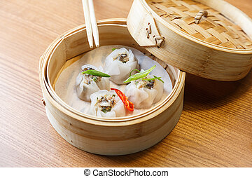 Dim sums with pork and mushrooms in asian restaurant