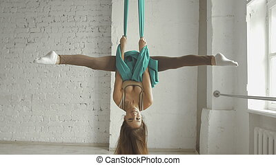 Beautiful Young Woman - Aerialist Doing Acrobatic Tricks On...