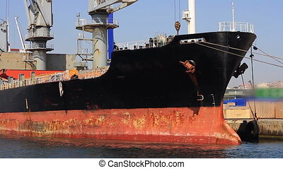Close-up pan of cargo freight ship - Close-up pan shot of...