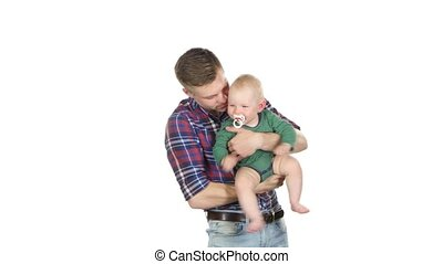 Father holding baby and playing with him. White - Father...