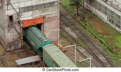 Passing cargo train in industrial plant - Passing cargo...