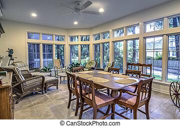 spacious sunroom with diningroom table