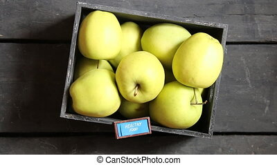 healthy food concept - text and fresh apples on a black table