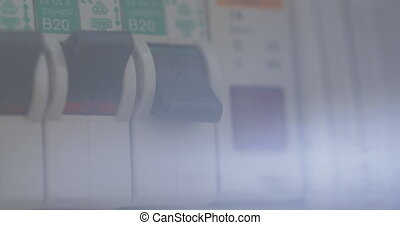 Turning on water heater on power panel - Close-up shot of...