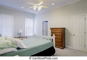 simple bedroom with bed and dresser