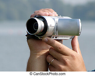 video camera - Digital video camera in hands...