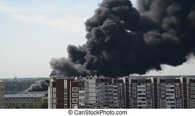 Black smoke from a major fire in Moscow, Russia - Black...