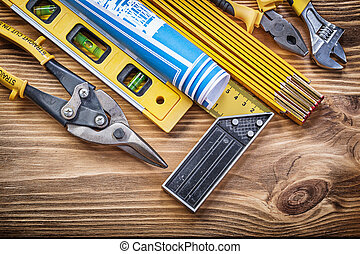 Set of building tools on vintage wooden board